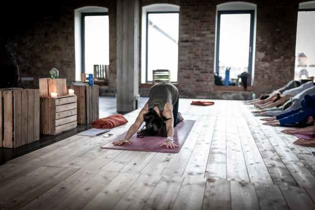 woman doing yoga technique inside a room